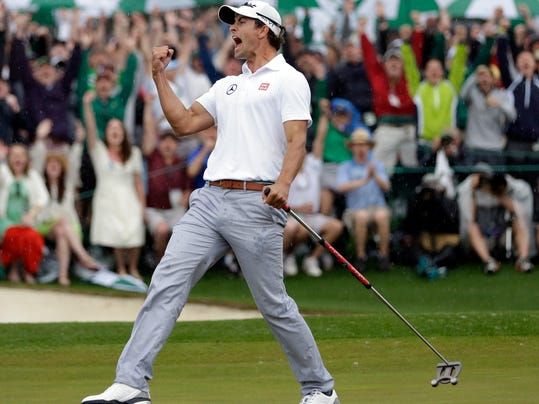 FILE - In this April 14, 2013, file photo, Adam Scott of Australia celebrates after a birdie putt on the 18th green during the fourth round of the Masters golf tournament in Augusta, Ga. Scott, whose world ranking has slid to No. 31, said Wednesday, Nov. 29, 2017, he will use a long-handled putter at the Australian PGA, similar to the now-banned broomstick version that he won the Masters with in 2013. He switched to a short putter from the broomstick one after a ban began in 2016 on anchoring the putter against the body. (AP Photo/David J. Phillip, File)