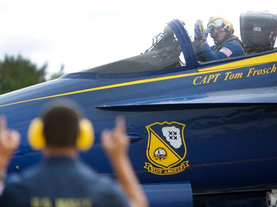 Blue Angel commander/leader  Capt. Tom Frosch, waves to one of the maintenance crew members  before taking off at Willow Run Airport, Thursday, August 27, 2015.