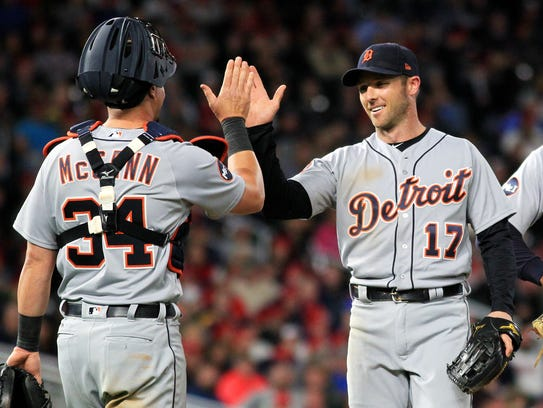 Tigers pitcher Andrew Romine is congratulated by teammate