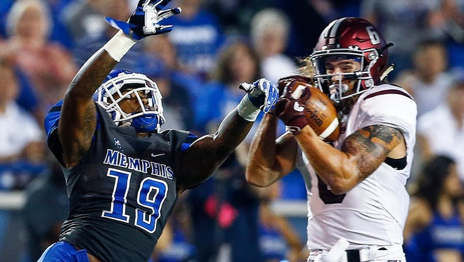 University of Memphis defender Shaun Rupert (left) can not break up a first down catch by Southern Illinois University receiver Connor Iwema (right) during first quarter action at the Liberty Bowl Memorial Stadium Saturday, September 23, 2017.
