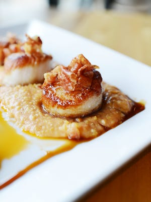 Sea scallops at Ambrozia Bar and Bistro, owned by chef Sam Etheridge.