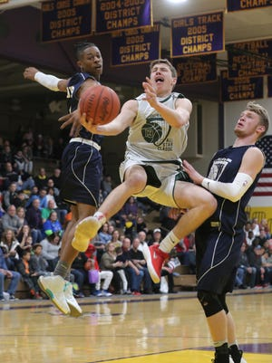 North all-star Max Loy of Buckeye Central drives between the South's Elijah Cobb (St. Peter's) and Brock Pletcher (Northmor) in the 40th News Journal All-Star Basketball Classic.