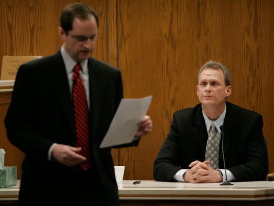 Steven Avery's attorney Jerome Buting walks away from Tom Fassbender, special agent with the state Depatment of Justice. Division of Criminal Investigation while questioning him at the  Steven Avery trial at the Calumet County Courthouse Friday, Feb. 16, 2007, in Chilton, Wis.  Avery is accused, along with his 17-year-old nephew, of killing Teresa Halbach, 25, after she went to the family's rural salvage lot to photograph a minivan they had for sale.  (AP Photo/The Post-Crescent, Kirk Wagner)