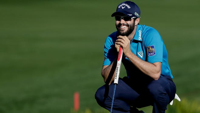 Adam Hadwin smiles on the 18th green on his way to shooting a 59 and taking the third round lead  Saturday in the CareerBuilder Challenge golf tournament at La Quinta Country Club.