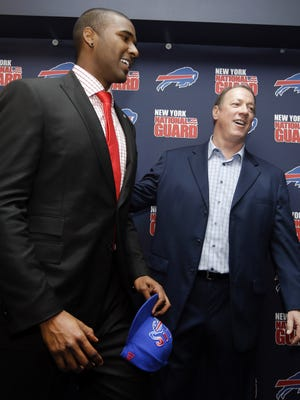 The Buffalo Bills No. 1 draft pick quarterback EJ Manuel, from Florida State, talks with former Bills quarterback Jim Kelly on April 26, 2013. Manuel was selected 16th overall in the first round of the 2013 NFL draft