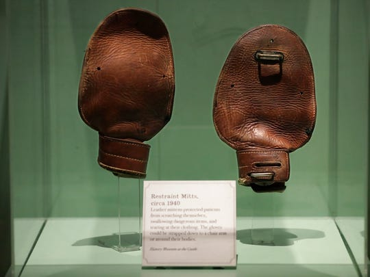 Restraint mitts are on display as part of the new Outagamie County Asylum for the Chronic Insane exhibit at the History Museum at the Castle.