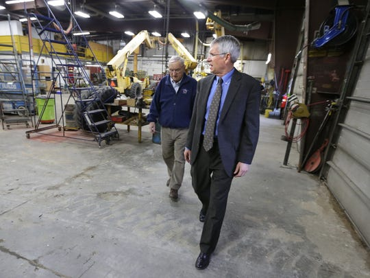 Tom Boldt, right, and Oscar Boldt, left, are both active in The Boldt Company. They represent the third and fourth generations of the Boldt family in the business.