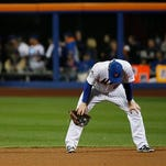 New York Mets' Daniel Murphy reacts after missing a ball hit by Kansas City Royals' Mike Moustakas during the eighth inning of Game 4 of the Major League Baseball World Series Saturday, Oct. 31, 2015, in New York.  (AP Photo/Matt Slocum)