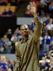 Jamal Mashburn Sr. waves to the crowd as his jersey was retired at UK in January 2000.