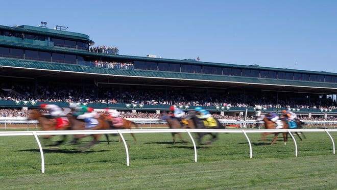 More than 32,000 people watched the action on Blue Grass Stakes day at Keeneland Race Course in Lexington, Ky., Saturday, April 8, 2017.