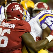 Alabama's A'Shawn Robinson wraps up LSU's Leonard Fournette.