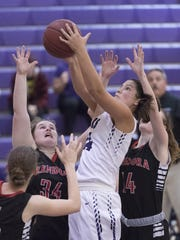 Mission Oak's Kayliegh Lopez gets a rebound between