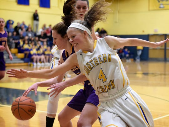 Lady Viking Cassiah Ray is denied the ball during Northern Lebanon's 51-25 loss to Lancaster Catholic Wednesday night.