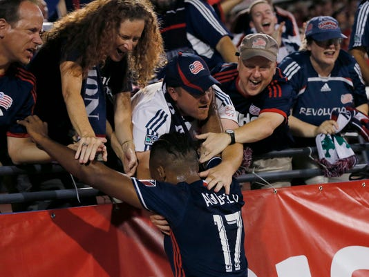 New England Revolution forward Juan Agudelo (17) celebrates with fans after scoring a goal against FC Dallas during the first half of the U.S. Open Cup soccer final, Tuesday, Sept. 13, 2016, in Frisco, Texas. (AP Photo/Tony Gutierrez)