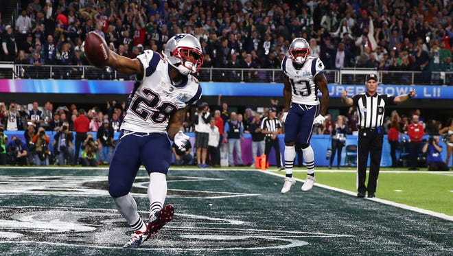 New England Patriots running back James White  celebrates after scoring a touchdown against the Philadelphia Eagles in the second quarter in Super Bowl LII.
