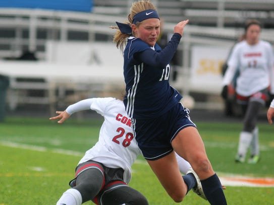 Notre Dame senior Maddie Wilhoite falls from a collision