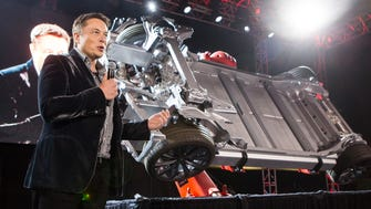 "Elon Musk, CEO of Tesla Motors Inc., announces its new Tesla ""D"", a new all-wheel-drive version of the Tesla Model S car in Hawthorne, Calif. in 2014. The company is acquiring a Grand Rapids-based auto supplier."