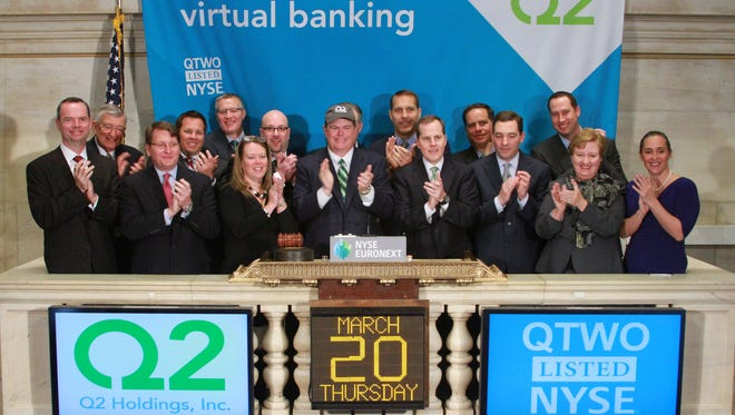 CEO and President Matt Flake Q2 Holdings, Inc. ring the opening bell at The New York Stock Exchange on March 20, 2014 in New York City.  (Photo by Dario Cantatore/NYSE Euronext)