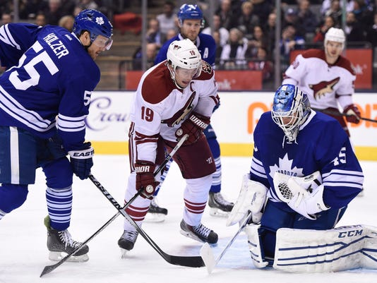 Arizona Coyotes' Shane Doan (19) looks for a rebound as Toronto Maple Leafs goalie Jonathan Bernier makes a save and Maple Leafs' Korbinian Holzer (55) defends during the first period of an NHL hockey game Thursday, Jan. 29, 2015, in Toronto. (AP Photo/The Canadian Press, Frank Gunn)