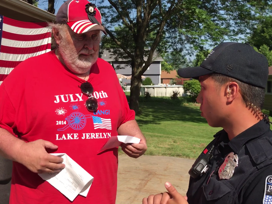 Frank Markel gets a ticket from a Greenfield police