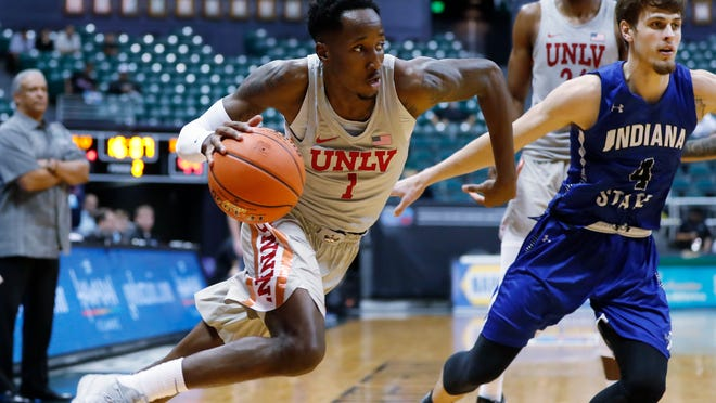 UNLV guard Kris Clyburn drives against Indiana State during the second half of Sunday's game in Honolulu. The Rebels lost twice at the Diamond Head Classic tournament.