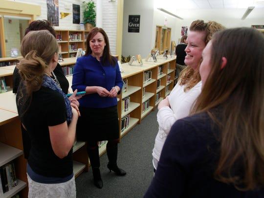 State Education Secretary Hanna Skandara talks with educators Thursday during a reception at Heights Middle School in Farmington.