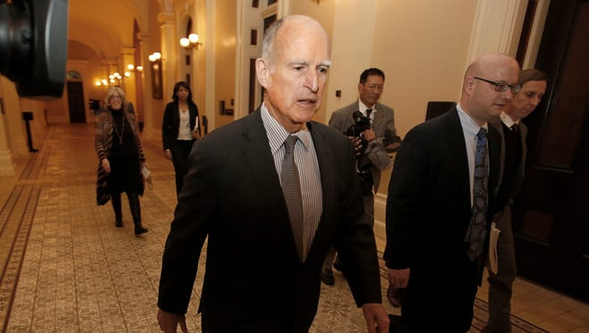 California Gov. Jerry Brown returns to his office after meeting with the Senate Democratic Caucus to urge them to approve a transportation plan on April 6, 2017, in Sacramento. The governor has the sole authority to appoint someone to complete the term of the late Riverside County Supervisor John Benoit.
