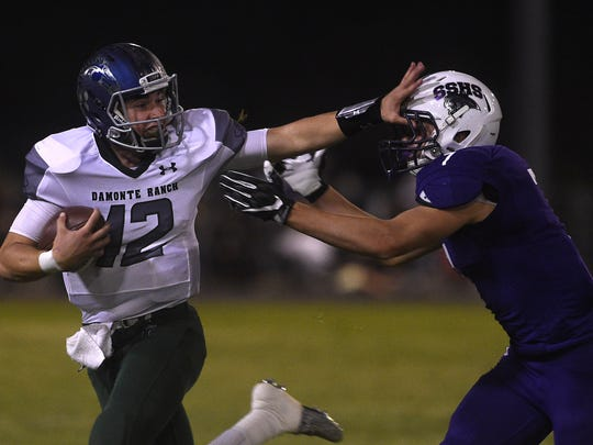 Damonte Ranch's Cade McNamara (12) runs free while taking on Spanish Springs during their football game at Spanish Springs on Sept. 15.