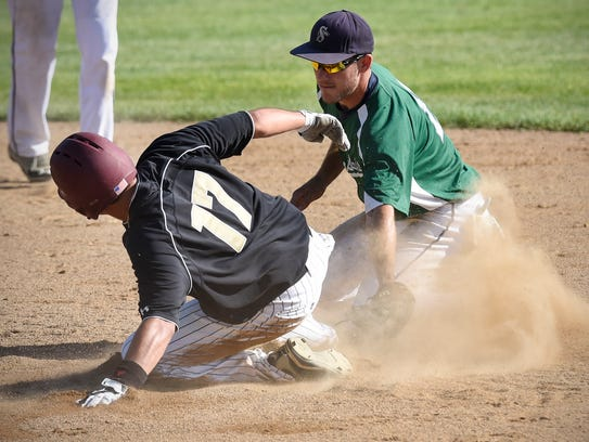 Jordan Clitty of the Sartell Stone Poneys tries to