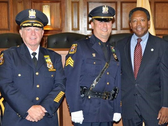 Linden Police Chief James M. Schulhafer, Sgt. William Bizub and Mayor Derek Armstead at Bizub's promotion ceremony at City Hall.