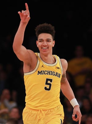 Michigan Wolverines big man D.J. Wilson reacts after a dunk against Marquette in the second half of the 2K Classic at Madison Square Garden on Nov. 17, 2016 in New York City.