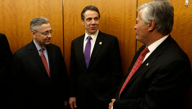 From left, Assembly Speaker Sheldon Silver, D-Manhattan, New York Gov. Andrew Cuomo, and Senate Republican leader Dean Skelos, R-Rockville Centre, talk on an elevator after a veterans event on March 20 in Albany.