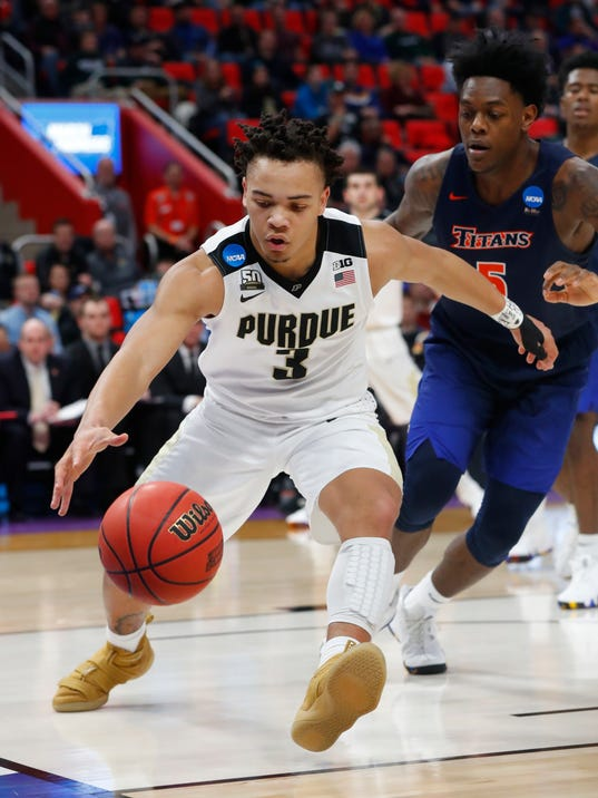 Purdue guard Carsen Edwards (3) collects a loose ball in front of Cal State Fullerton forward Davon Clare (5) during the second half of an NCAA men's college basketball tournament first-round game in Detroit, Friday, March 16, 2018. Purdue won 74-48. (AP Photo/Paul Sancya)