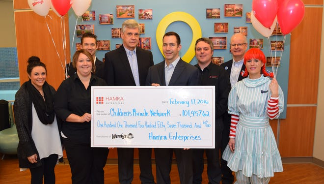 From left to right: Brittany Combs, marketing manager; Regina Geer, district manager; Justin Bess, assistant executive director, CMN Hospitals at CoxHealth; Chuck Ocarz, president of Wendy's of Missouri and Wendy's of New England; Mike Hamra, CEO; Josh Sloan, district manager; Tim Siebert, executive director, CMN Hospitals at CoxHealth; Wendy.
