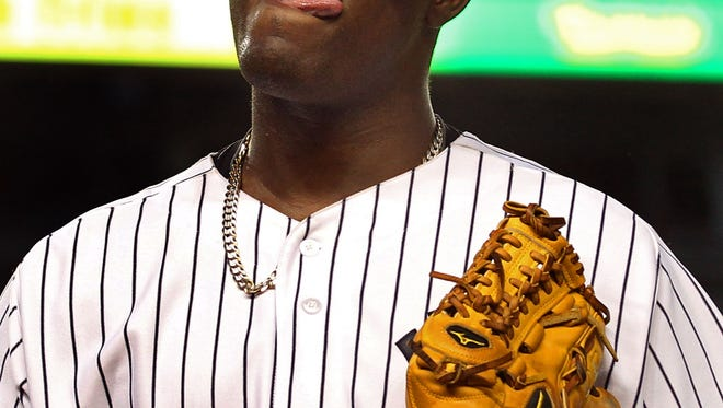 Yankees starting pitcher Michael Pineda  reacts as he heads to the dugout during the third inning of Wednesday night's game against the Houston Astros at Yankee Stadium.