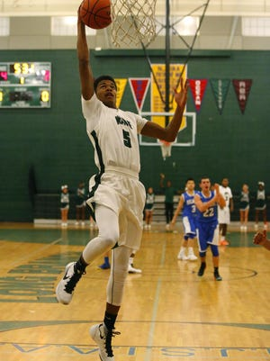 TJ Mosque of Long Branch scores an uncontested basket against Holmdel during boys basketball game at Long Branch High School.