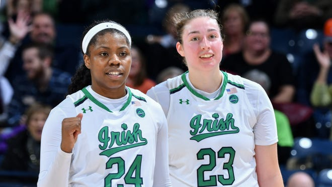Notre Dame Fighting Irish guard Arike Ogunbowale (24) and forward Jessica Shepard (23) celebrate in the second half against the DePaul Blue Demons at the Purcell Pavilion.