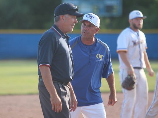 Germantown head coach Jeff Wolf argues with an umpire about a call made in the sixth inning of Monday's sectional final against Menomonee Falls.