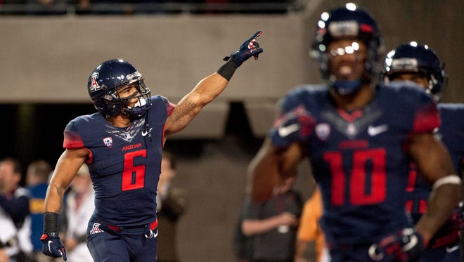 Nov 14, 2015: Arizona Wildcats wide receiver Nate Phillips (6) celebrates after scoring a touchdown against the Utah Utes during the second overtime at Arizona Stadium. Arizona won 37-30 in double overtime.