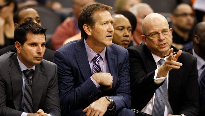 Phoenix Suns head coach Jeff Hornacek is flanked by assistant coaches Mike Longabardi (left) and Jerry Sichting (right).