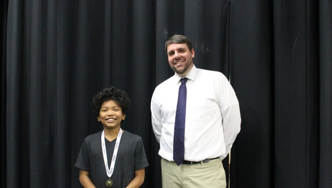 Michael Sowell, a Central Magnet School seventh-grader, is pictured with Central Magnet geography teacher Clay Burns after winning the school's geography bee Jan. 21.