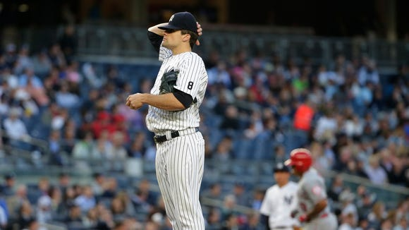 New York Yankees starting pitcher Nathan Eovaldi reacts as Los Angeles Angels' Jefry Marte runs the bases after hitting a home run during the third inning of a baseball game Wednesday, June 8, 2016, in New York.