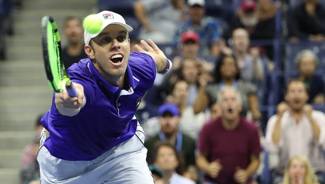 Sam Querrey stretches to hit a forehand during his 7-6 (5), 6-7 (9), 6-3, 7-6 (7) loss to South Africa's Kevin Anderson in a quarterfinal match late Tuesday night at the U.S. Open.