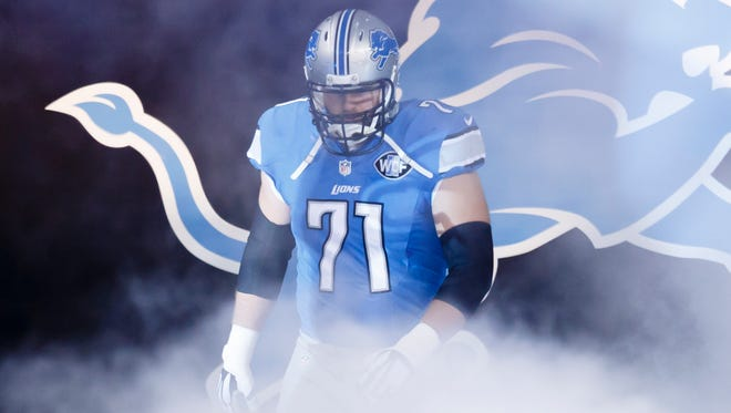 Detroit Lions tackle Riley Reiff is introduced before a game against the Miami Dolphins at Ford Field on Nov. 9, 2014.