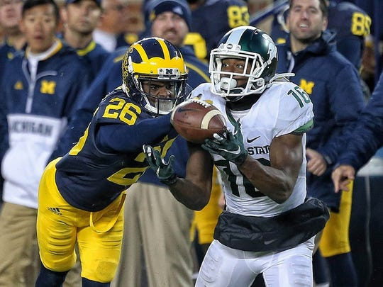 Michigan's Jourdan Lewis battles Michigan State's Aaron