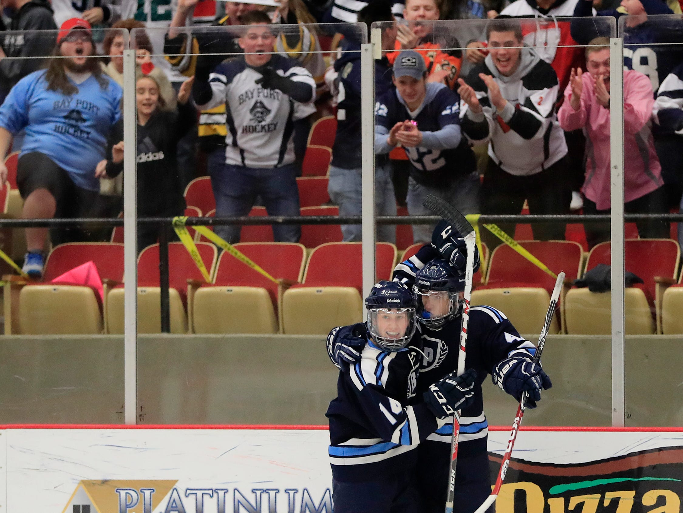 Bay Port Pirates defenseman Joe Cavil (14) and forward Max Moore (44) after Moore scored a goal against the Sun Prairie Cardinals in a quarterfinal match at the 2017 State Hockey Tournament at Veterans Memorial Coliseum on Thursday, March 2, 2017, in Madison, Wis. Sun Prairie won the match, 3-2. Adam Wesley/USA TODAY NETWORK-Wisconsin