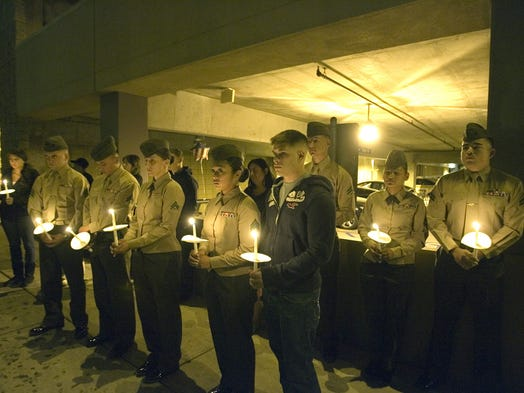 Marines from the Combat Logistic Batalion 7 who served with Cpl. Allan DeVillena II attend a candlelight vigil for him at the parking garage where he was fatally shot by Palm Springs Police on November 10th. Photo taken on Thursday, November 15, 2012.  (Richard Lui The Desert Sun)