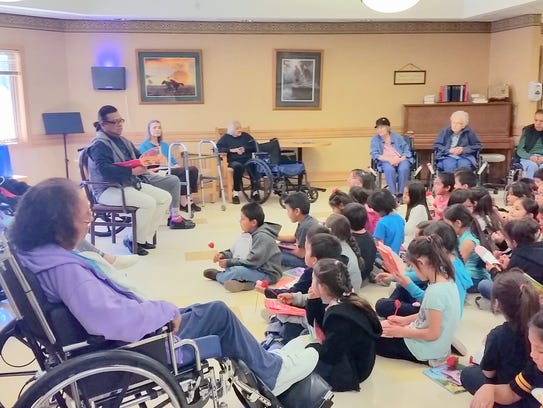 First graders read to residents at the Mescalero Care