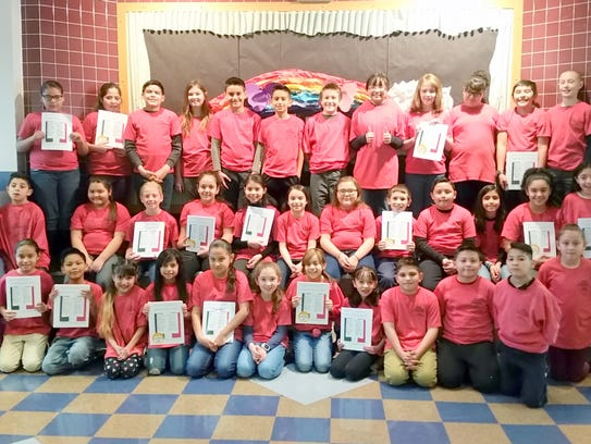 The 4th-grade authors and illustrators pose with their