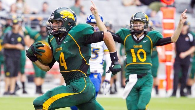 Show Low's Josh Weeks runs for a touchdown during a game against Nevada's Moapa Valley at the Barry Sollenberger Classic at University of Phoenix Stadium in Glendale on Saturday, Aug. 20, 2011.